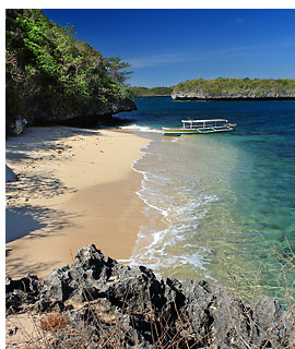 view of the beach on Marcos Island from the trail leading to Imelda Cave, Hundred Islands National Park