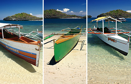 outrigger boats docked on the beach at Quezon Island, Hundred Islands