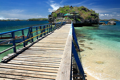 wooden walkway leading to a rock islet at Quezon Island, Hundred Islands National Park
