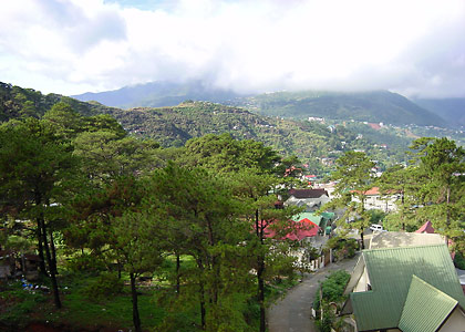 a residential area in Baguio City with Marcos Highway in the background