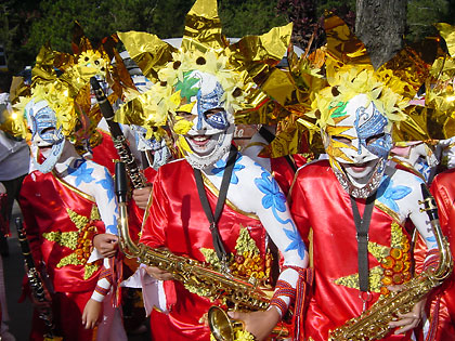 horn players in colorful costumes at a Panagbenga Festival parade