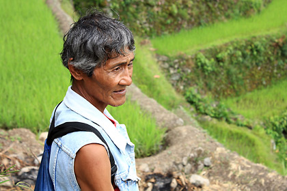 Batad guide Manong Jun stops briefly at the terraces