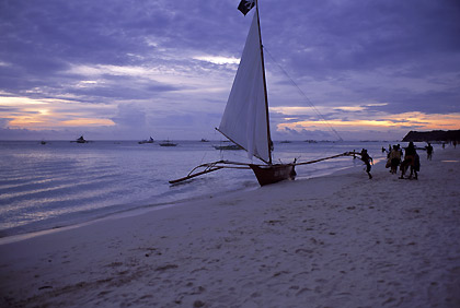 beached outrigger boat at dusk, Boracay
