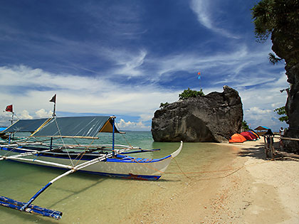 boats, tents and huts at Borawan beach, Padre Burgos, Quezon