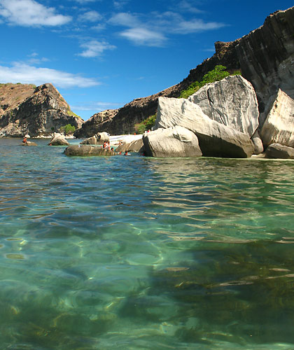 clear waters and beach with huge rocks, Capones Island