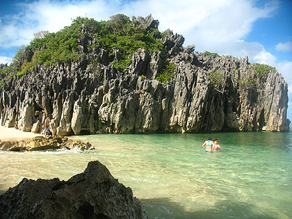 limestone karst formation and beach at Lahos Island