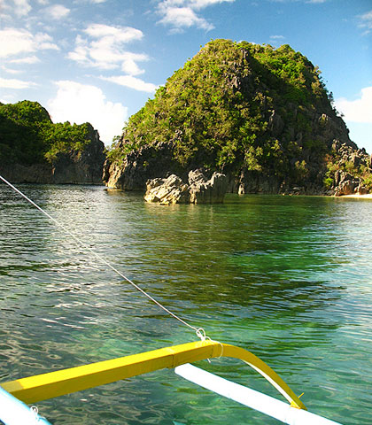 view of Tinago Cove from an outrigger boat