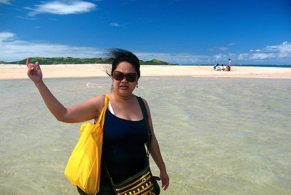 Nina motioning to the group at the pink sandy beach of Cotivas Island