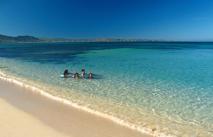 local folk swimming in the crystal clear waters of Saud Beach