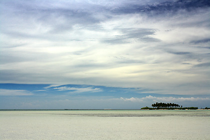 view of Tondol Beach and Tanduyong Island in Anda with clouds overhead