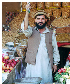 Pashtun market vendor at his shop, a market in Peshawar, Pakistan
