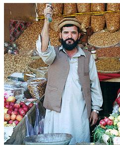 Pashtun market vendor at his shop, a market in Peshawar, Pakistan