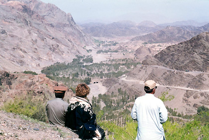 visitors at the highest point of the Khyber Pass inside Pakistan looking down on the descent to Afghanistan