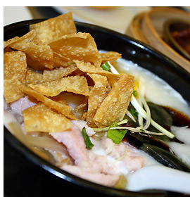 Chinese congee with chicken strips and century egg
